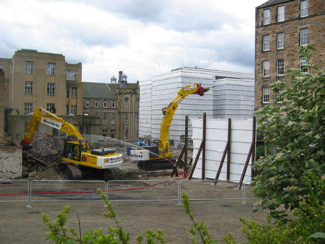 The demolition of the old RIE, showing Lister's Lauriston Terrace flats on the right.